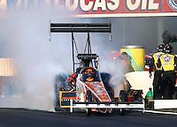 Nov 10, 2013; Pomona, CA, USA; NHRA top fuel dragster driver Clay Millican during the Auto Club Finals at Auto Club Raceway at Pomona. Mandatory Credit: Mark J. Rebilas-
