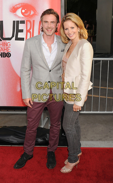 "Sam Trammell, Missy Yager.HBO's ""True Blood"" Season 5 Premiere, Hollywood, California, USA..May 30th, 2012.full length grey gray suit jacket beige white shirt maroon burgundy trousers jeans denim married husband wife .CAP/ROT/TM.©Tony Michaels/Roth Stock/Capital Pictures"