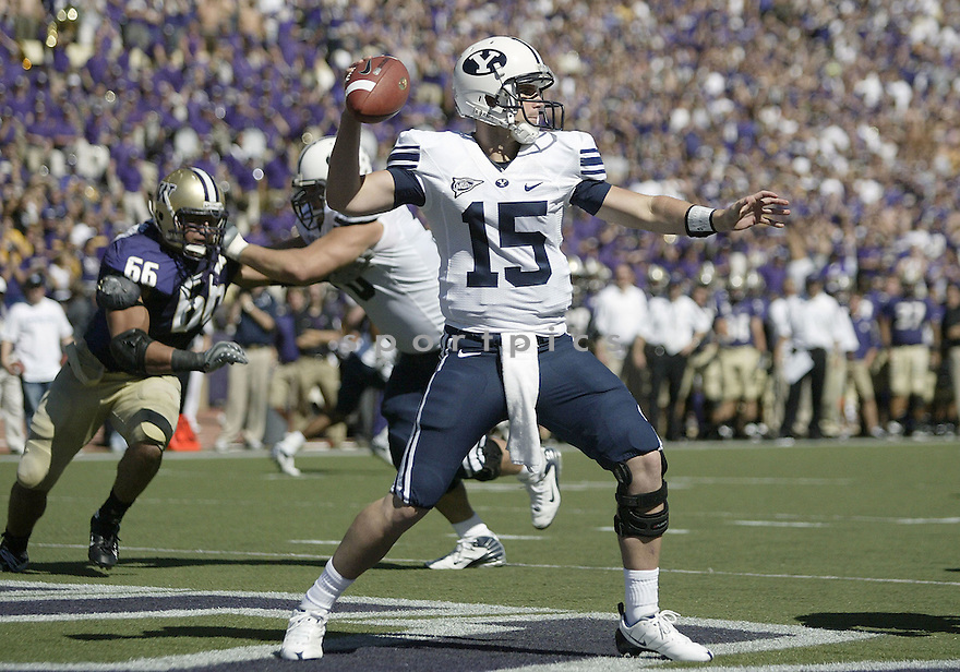 06, Sept 2008:  BYU quarterback Max Hall throws the ball from his own end zone for a first down against UW.  BYU defeated UW 28-27 with a end of the game blocked extra point at University of Washington in Seattle, WA.