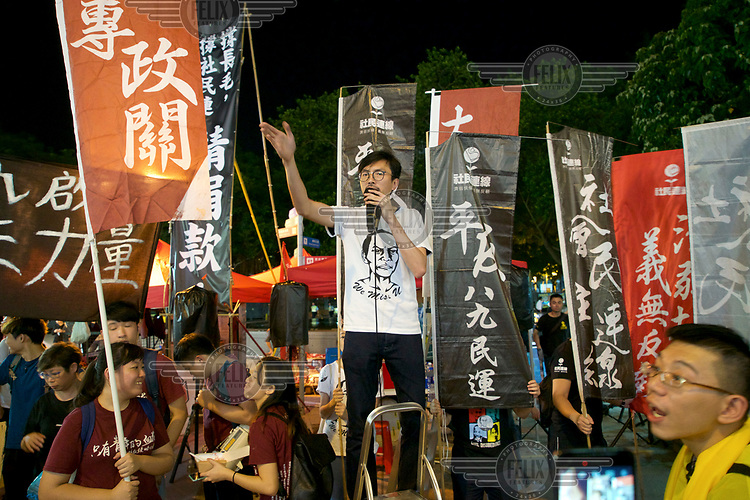A man speaks as thousands of people gathered on 4 June 2016, to commemorate the massacre of pro-democracy protesters in Tiananmen Square in 1989.
