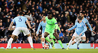 FC Schalke 04&rsquo;s Breel Embolo under pressure from Manchester City's Danilo (left) and Bernardo Silva<br /> <br /> Photographer Rich Linley/CameraSport<br /> <br /> UEFA Champions League Round of 16 Second Leg - Manchester City v FC Schalke 04 - Tuesday 12th March 2019 - The Etihad - Manchester<br />  <br /> World Copyright &copy; 2018 CameraSport. All rights reserved. 43 Linden Ave. Countesthorpe. Leicester. England. LE8 5PG - Tel: +44 (0) 116 277 4147 - admin@camerasport.com - www.camerasport.com