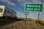 Winterhaven, CA, U.S.-MARCH 24: -Snowbirds travel by RV along Interstate Highway 8 from Yuma, Arizona towards the Mexican border March 24, 2005 in California. Arizona has become a popular destination for Snowbirds, retirees who spend the winter months in warmer climates, with many thousands taking advantage of the close proximity of Algodones, Mexico to cross the border for less expensive medical services and prescription drugs. ©Radhika Chalasani