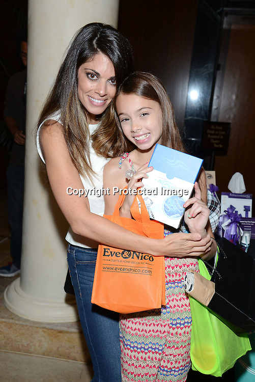 Lindsay Hartley and daughter Isabella attends the 2015 Daytime Emmy Gifting Suite on April 25, 2015 at Warner Brothers Stuido Lot  in Burbank, California, USA. The gift lounge was presented by OffTheWallIdeas.com.
