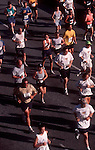 Seattle, Runners competing in the Seattle Seafair Torchlight 10k Run,.