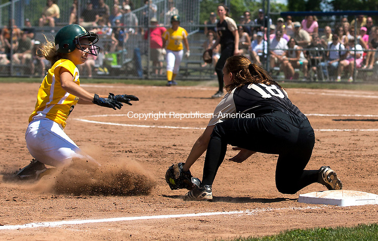 West Haven, CT- 13 June 2015-061315CM12-   Holy Cross' Sydney McIldowie slides into third base as Thomaston's Nina Barone tags her out during the Class S state softball final in West Haven on Saturday.  Christopher Massa Republican-American