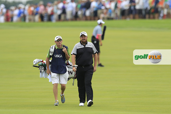 Shane Lowry (IRL) and caddy Dermot Byrne on the 4th hole during Thursday's Round 1 of the 2016 U.S. Open Championship held at Oakmont Country Club, Oakmont, Pittsburgh, Pennsylvania, United States of America. 16th June 2016.<br /> Picture: Eoin Clarke | Golffile<br /> <br /> <br /> All photos usage must carry mandatory copyright credit (&copy; Golffile | Eoin Clarke)