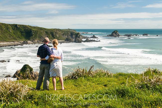 Tourists enjoying views on popular walk along coastline on Cape Foulwind near Westport, West Coast, Buller Region, New Zealand