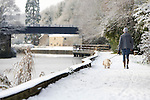 Pix: Shaun Flannery/shaunflanneryphotography.com...COPYRIGHT PICTURE>>SHAUN FLANNERY>01302-570814>>07778315553>>..29th November 2010.........Snowfall in the United Kingdom, November 2010..A dog walker walks down the snow covered tow path at Sprotbrough Lock, part of the Trans Pennine Trail.
