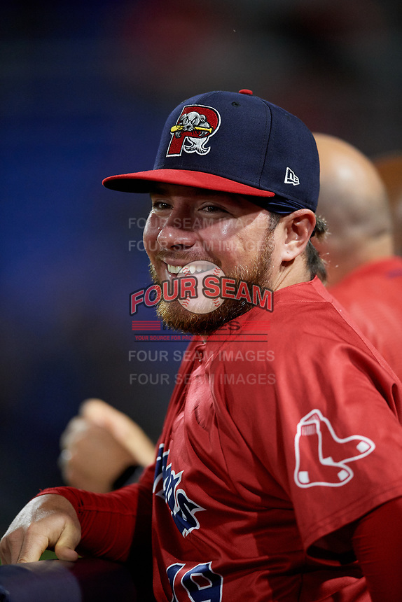 Portland Sea Dogs Esteban Quiroz (19) in the dugout during a game against the Binghamton Rumble Ponies on August 31, 2018 at NYSEG Stadium in Binghamton, New York.  Portland defeated Binghamton 4-1.  (Mike Janes/Four Seam Images)