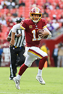 Landover, MD - September 16, 2018: Washington Redskins quarterback Alex Smith (11) runs the ball during the  game between Indianapolis Colts and Washington Redskins at FedEx Field in Landover, MD.   (Photo by Elliott Brown/Media Images International)