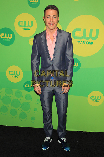 Colton Haynes.At The CW Upfront 2013 Green Carpet Arrivals outside the London Hotel, New York, NY, USA, May 16th, 2013..full length blue suit  shiny pink shirt .CAP/LNC/TOM.©TOM/LNC/Capital Pictures.