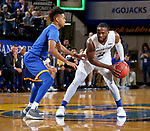 SIOUX FALLS, SD - NOVEMBER 28: Tevin King #2 from South Dakota State University looks to make a move against Rob Whitfield #2 from UMKC during their game Wednesday night at Frost Arena in Brookings, SD. (Photo by Dave Eggen/Inertia)