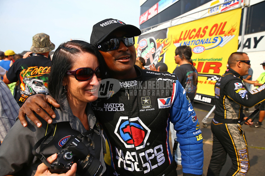 Aug. 18, 2013; Brainerd, MN, USA: NHRA top fuel dragster driver Antron Brown poses with an NHRA official during the Lucas Oil Nationals at Brainerd International Raceway. Mandatory Credit: Mark J. Rebilas-