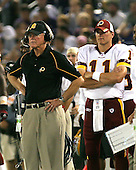 Washington Redskins head coach Joe Gibbs watches from the sidelines as his offense works against the Baltimore Ravens during a pre-season game at M&T Bank Stadium, Baltimore, Maryland on September 1, 2005. At right is  QB Patrick Ramsey (11). <br /> Credit: Arnie Sachs / CNP