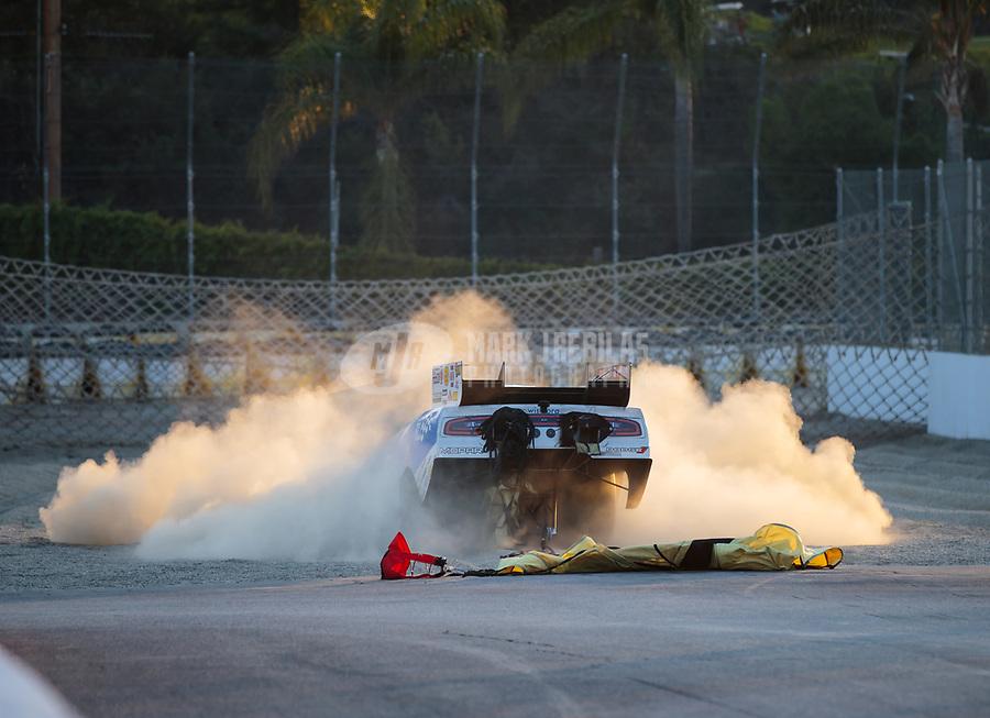 Nov 11, 2018; Pomona, CA, USA; Dust flies as NHRA funny car driver Tommy Johnson Jr goes into the sand trap during the Auto Club Finals at Auto Club Raceway. Mandatory Credit: Mark J. Rebilas-USA TODAY Sports