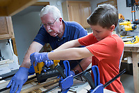 NWA Democrat-Gazette/CHARLIE KAIJO Don Lowe (left) and his grandson Jeremiah Lowe, 11, (right) create an American flag out of wood pieces, Monday, August 12, 2019 at Don's home in Bella Vista.<br /> <br /> Don Lowe and his grandson, Jeremiah Lowe, 11, turned their woodcrafting hobby into a business nine months ago after Don sold one of his wooden flags on Facebook within the first hour of posting it. It's a casual hobby he and his grandson share but they've sold 30 now in over four states, many to retired and active service members and emergency responders. He is working on a wooden flag he and his grandson will donate to the Bella Vista Fire Department.
