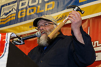 Race Marshal Mark Nordman announces a Golden Hammer award to volunteer Jim Paulus for all his help on the race at the musher 's finishers banquet in Nome on Sunday March 16 after the 2014 Iditarod Sled Dog Race.<br /> <br /> PHOTO (c) BY JEFF SCHULTZ/IditarodPhotos.com -- REPRODUCTION PROHIBITED WITHOUT PERMISSION