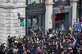 26/03/2011. Anti-Cuts Demonstration in Central London. Protesters attacking Lloyds TSB branch in Piccadilly.