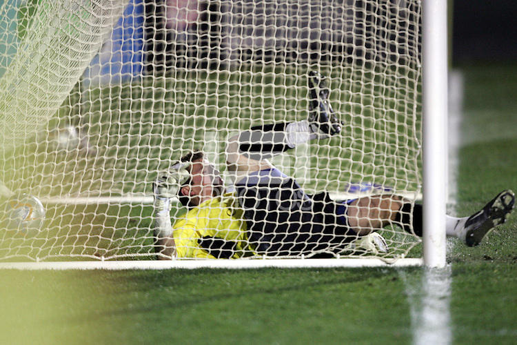 Clemson goalkeeper Phil Marfuggi and the ball end up in the net.  The goal by New Mexico's Andrew Boyens (not pictured) gave UNM its 2-1 margin of victory. The University of New Mexico defeated Clemson University 2-1 in the NCAA Semifinal at SAS Stadium in Cary, North Carolina, Friday, December 9, 2005.