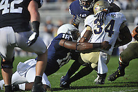 15 September 2012:  Penn State DE Deion Barnes (18) and DE C.J. Olaniyan (86) tackle Navy RB Noah Copeland (34). The Penn State Nittany Lions defeated the Navy Midshipmen 34-7 at Beaver Stadium in State College, PA..