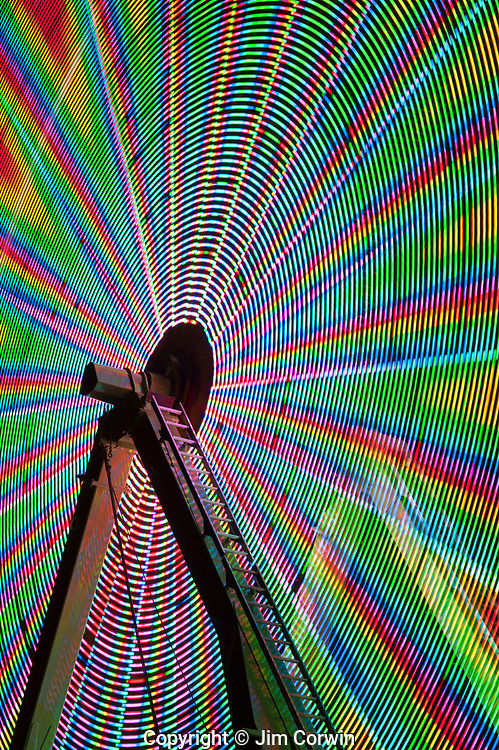 Ferris wheel in motion with multi colors, abstract patterns of colors