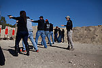 Teachers from Killeen ISD earn their concealed handgun license from Big Iron CHL, owned by Johnny Price. CREDIT: Lance Rosenfield/Prime