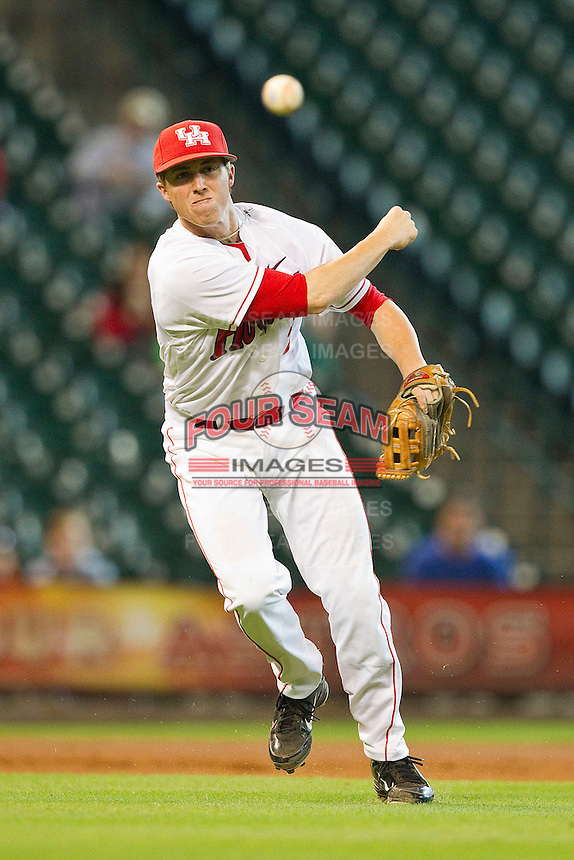 Third baseman Kendall Stacks #27 of the Houston Cougars makes a throw to first base against the Arkansas Razorbacks at Minute Maid Park on March 3, 2012 in Houston, Texas.  The Cougars defeated the Razorbacks 4-1.  Brian Westerholt / Four Seam Images