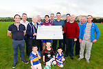 Pat Sheehan (fundraiser organiser) and Ollie Favier (The Shire Bar, Killarney) presenting a cheque for €2865 to Committee members of Barraduff Community Field Project in Barraduff last Saturday.