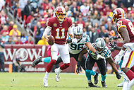Landover, MD - October 14, 2018: Washington Redskins quarterback Alex Smith (11) scrambles during the  game between Carolina Panthers and Washington Redskins at FedEx Field in Landover, MD.   (Photo by Elliott Brown/Media Images International)