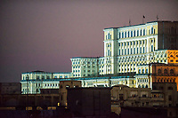 The Palace of Parliament, the largest office building in the world after the Pentagon, towers over the skyline of Bucharest, Romania