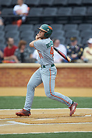 Adrian Del Castillo (44) of the Miami Hurricanes follows through on his swing against the Wake Forest Demon Deacons at David F. Couch Ballpark on May 11, 2019 in  Winston-Salem, North Carolina. The Hurricanes defeated the Demon Deacons 8-4. (Brian Westerholt/Four Seam Images)