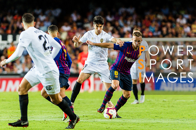 Arthur Melo of FC Barcelona (R) in action against Ruben Nunes Vezo of Valencia CF (C) during their La Liga 2018-19 match between Valencia CF and FC Barcelona at Estadio de Mestalla on October 07 2018 in Valencia, Spain. Photo by Maria Jose Segovia Carmona / Power Sport Images