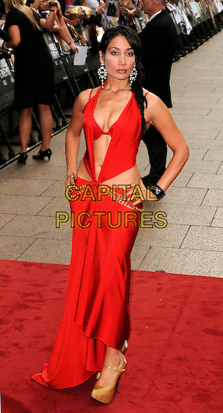 SOPHIA HYATT.European Premiere of 'Public Enemies' at the Empire Cinema, Leicester Square, London, England..June 29th 2009.full length sofia sophiya sofiya red dress hands on hips cleavage gold chain bra plunging neckline .CAP/CAN.©Can Nguyen/Capital Pictures.