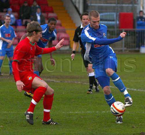 5th December 2009. Totton's Michael Gosney (blue shirt) controls the ball under pressure from a Windsor defender during the first half. Zamaretto League Division One South and West match - Windsor & Eton v AFC Totton at Windsor, Berkshire, England.Photo: Colin Read/Actionplus - Editorial Worldwide use