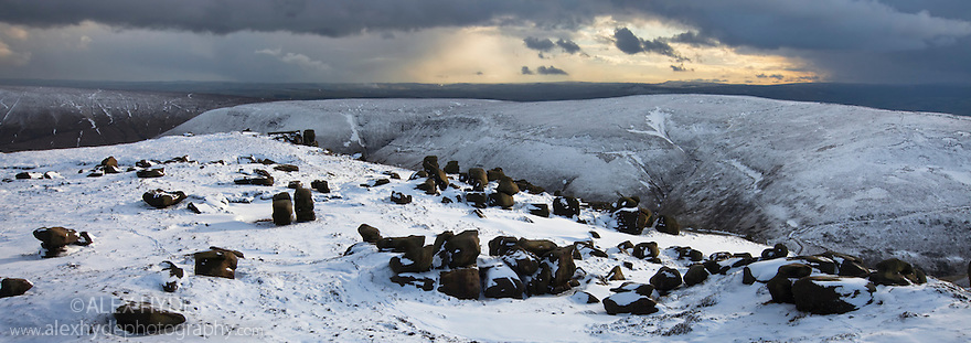 The Wool Packs, an area of weathered gritstone boulders, after heavy snowfall. Peak District National Park, Derbyshire, UK. February