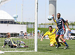 17 June 2007: Columbus's Jason Garey (center) watches his shot rebound past the post with New England's Brad Knighton (24) and Amaechi Igwe (2). The New England Revolution Reserves defeated the Columbus Crew Reserves 2-1 on the Gillette Stadium practice field in Foxboro, Massachusetts in a Major League Soccer Reserve Division game.