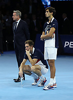 Pierre-Hughes Herbert and partner Nicolas Mahu with their runners-up trophies after their match against Jack Sock and Mike Bryan in their doubles Final match today<br /> <br /> Photographer Rob Newell/CameraSport<br /> <br /> International Tennis - Nitto ATP World Tour Finals Day 8 - O2 Arena - London - Sunday 18th November 2018<br /> <br /> World Copyright &copy; 2018 CameraSport. All rights reserved. 43 Linden Ave. Countesthorpe. Leicester. England. LE8 5PG - Tel: +44 (0) 116 277 4147 - admin@camerasport.com - www.camerasport.com