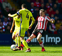 Lincoln City's Harry Andersonvies for possession with  Cheltenham Town's Ben Tozer<br /> <br /> Photographer Andrew Vaughan/CameraSport<br /> <br /> The EFL Sky Bet League Two - Lincoln City v Cheltenham Town - Saturday 13th April 2019 - Sincil Bank - Lincoln<br /> <br /> World Copyright &copy; 2019 CameraSport. All rights reserved. 43 Linden Ave. Countesthorpe. Leicester. England. LE8 5PG - Tel: +44 (0) 116 277 4147 - admin@camerasport.com - www.camerasport.com