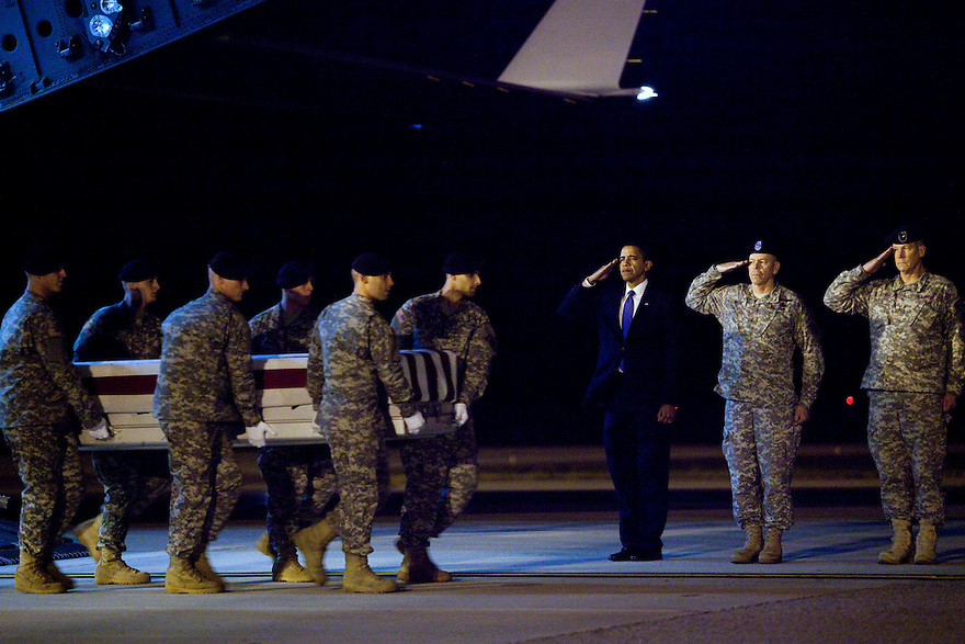 President Barack Obama (C) participates in the dignified transfer of U.S. Army Sgt. Dale R. Griffin at Dover Air Force Base, Delaware. Griffin is one of 18 U.S. personnel who died Monday in Afghanistan and returned to the U.S. on board an Air Force C-17 military transport plane.....................