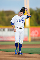 Riley King (32) of the Burlington Royals removes his batting helmet following the third out of an inning during the game against the Johnson City Cardinals at Burlington Athletic Park on August 22, 2015 in Burlington, North Carolina.  The Cardinals defeated the Royals 9-3. (Brian Westerholt/Four Seam Images)