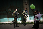 An Israeli soldiers secures a parade marking the Jewish holiday of Purim, a celebration of the Jews' salvation from genocide in ancient Persia, as recounted in the Book of Esther, in the West Bank city of Hebron March 12, 2017. Photo by: JINIPIX