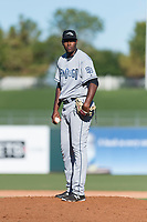 Peoria Javelinas relief pitcher Dauris Valdez (50), of the San Diego Padres organization, looks in for the sign during an Arizona Fall League game against the Surprise Saguaros at Surprise Stadium on October 17, 2018 in Surprise, Arizona. (Zachary Lucy/Four Seam Images)