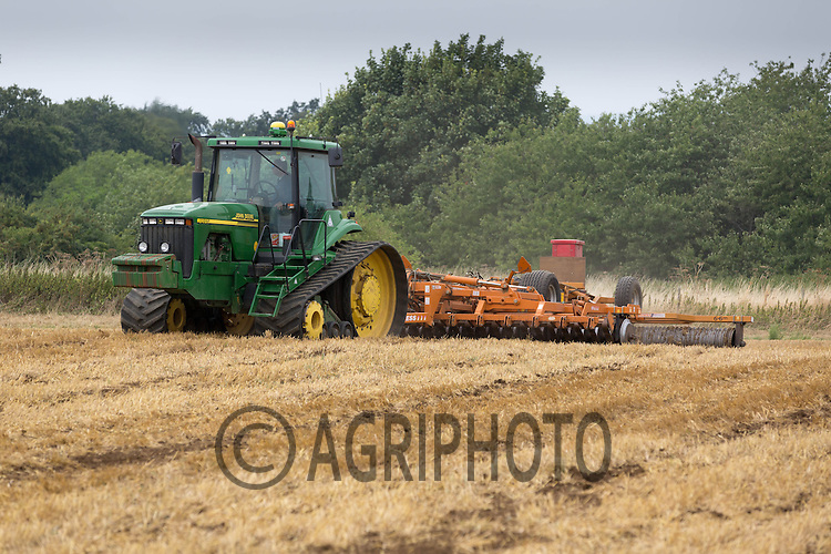 John Deere crawler rolling and applying slug pellets to a Wheat stubble field drilled with rape<br /> Picture Tim Scrivener 07850 303986