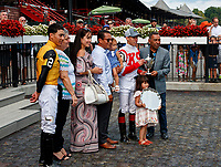 Irad Ortiz is honored as he wins the Angel Cordero riding title for the 2018 Saratoga meet.  His brother Irad joined in the celebration.  (Bruce Dudek/Eclipse Sportswire)