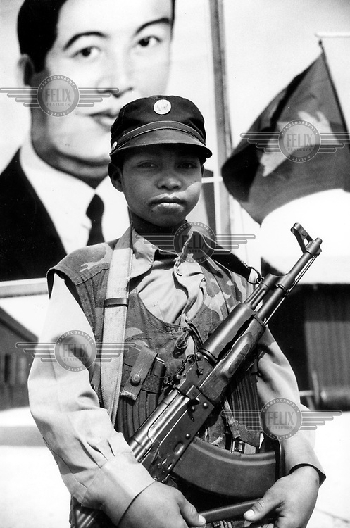 ©Nic Dunlop/Panos Pictures..Cambodia. Kandal province. 14 year old Cambodian soldier.