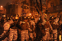 Police forces seen during assault on barricades in  government district in Kiev. Ukraine