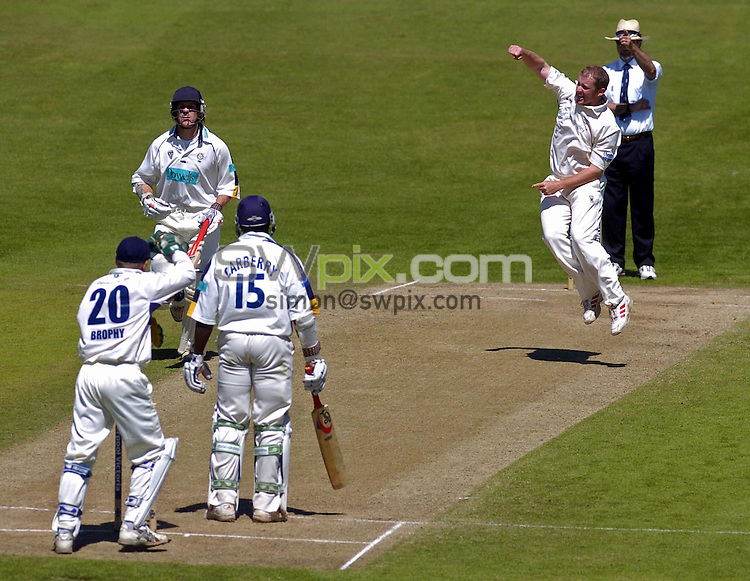 PICTURE BY VAUGHN RIDLEY/SWPIX.COM -  Cricket - Liverpool Victoria County Championship, Day Four - Yorkshire v Hampshire - Headingley, Leeds, England - 03/06/06...? Simon Wilkinson - 07811 267706...Yorkshire's Anthony McGrath gets the wicket of Hampshire's Michael Carberry.