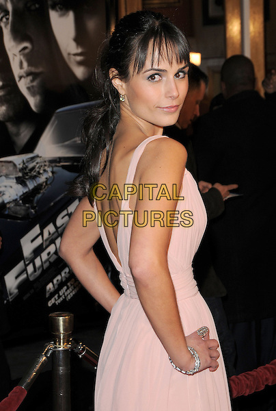"""JORDANA BREWSTER.World Premiere of """"Fast & Furious"""" held at Gibson Ampitheatre in Universal City, California, USA. .March 12th, 2009                                                                     half length pink dress hand on hip looking over shoulder .CAP/DVS.©Debbie VanStory/Capital Pictures."""