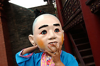 """Money God'""s helper in a temple in Pingyao of Shannxi, which is one of the last cities in China that retains traditional Chinese architecture..19-SEP-04"