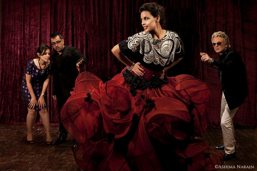 Rohit Bal, a celebrated Indian fashion designer (right) with his proteges - Pankaj & Nidhi, who now have their own label. Model, Deepti Gujral, wears a mix of Rohit Bal & Pankaj & Nidhi. Photographed for Harper's Bazaar.